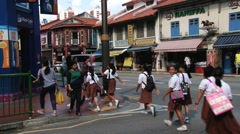 School children cross street at the Indian quarter in Singapore, Singapore. Stock Footage