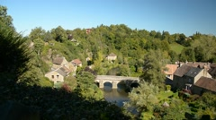 Windy scene of the bridge of the beautiful French town Saint-Céneri-le-Gérei Stock Footage