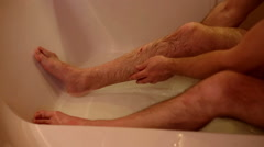 Man is sitting in bath and washed wound  - stock footage
