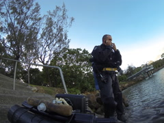 Josh full dive sequence clip 1, starts dive chatting to fishermen, shows final Stock Footage