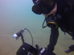 Josh full dive sequence clip 4, starts on sandy tripod shot, swimming filming, Stock Footage