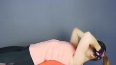 Young girl athlete trains the press, doing exercises on the fitball Stock Footage