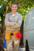 Handyman with tool belt around waist - stock photo