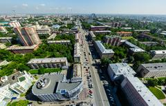 Aerial city view with crossroads and roads, houses buildings. Copter shot - stock photo
