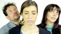Concept of unhappiness and boredom of three people isolated slow motion Stock Footage