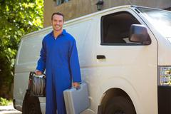 Mechanic with a tool box - stock photo
