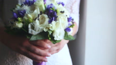 the bride holding a wedding bouquet - stock footage