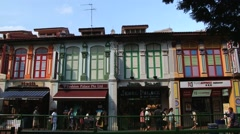 People walk by the street in the Indian quarter in Singapore, Singapore. Stock Footage
