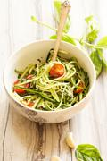 Zucchini pasta noodles with dressing in a white bowl Stock Photos