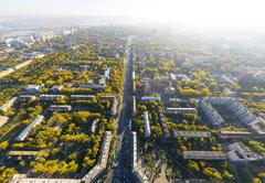 Aerial city view with crossroads, roads, houses, buildings and parks Stock Photos