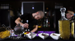 Bartender is making cocktail at bar counter, Night club Stock Footage