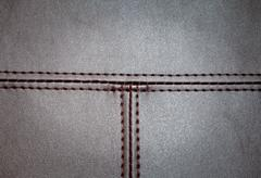 leather texture wiith a horizontal and vertical seam - stock photo