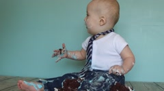 Excited baby sitting on cake Stock Footage