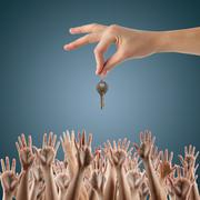 REAL ESTATE concept. Many hands want to get the key - stock photo