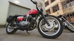 View of motorcycles with red details. Summer evening. Bikers. Abandoned building Stock Footage