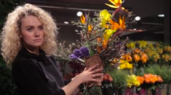 Florist girl with a beautiful bouquet in flower shop Arkistovideo