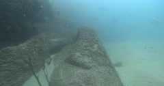 Fast and turbulent drift with incoming tide along most of rock wall, goes past Stock Footage