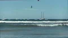 Costa Rica Windy at the shore line Beach Ocean Boats Pelicans- - stock footage