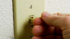 Mans hand turning the light switch on 4k Stock Footage