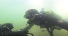 Videographer diving on silty river bed in Australia, 2.7K UltraHD, UP34620 Stock Footage