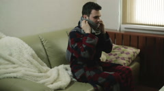 A man in a gown comes into the room, puts on a scarf and lies down Stock Footage