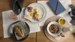 Top View of Healthy Breakfast in Cafe. English breakfast: fried egg, bacon toast - stock footage