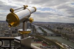 Telescope with view of Paris in background Stock Photos