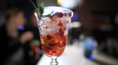 Beautiful red cocktail on the bar Stock Footage