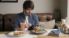 Hipster Man Using Digital Tablet  Eating Healthy Breakfast Stock Footage