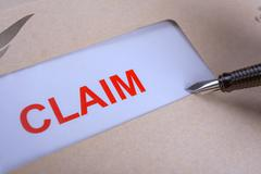 Stock Photo of Claim form in brown envelope, can use insurance concept