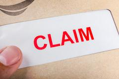 Claim form in brown envelope, can use insurance concept - stock photo