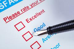 Customer satisfaction survey checkbox with rating and pen pointing at Good, c - stock photo