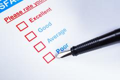 Customer satisfaction survey checkbox with rating and pen pointing at Poor, c - stock photo