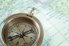 Compass on map background, use for travel concept - stock photo