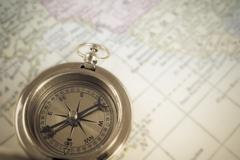 Compass on map background, use for travel concept Stock Photos