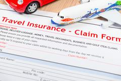 Travel Insurance Claim application form on table, business and risk concept;  - stock photo