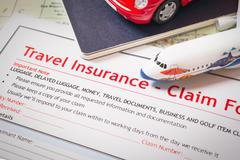 Travel Insurance Claim application form on table, business and risk concept;  Stock Photos