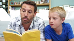 Father reading a story to his son Arkistovideo