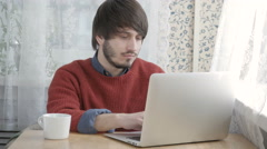 Happy Young Man Freelancer with Modern Laptop in Cafe taking Cup of Coffee Stock Footage