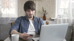Happy Young Man Freelancer with Modern Laptop Buying by  Credit Card. Online Stock Footage