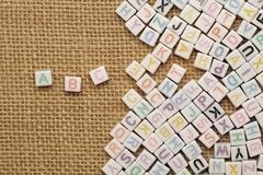 Abc english alphabet on burlap background Stock Photos