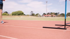 Woman practicing hurdle race Stock Footage