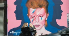 People in Front of David Bowie Mural in New York City 4K Stock Video Stock Footage