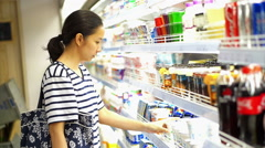 Asian girl shopping drinks and beverage in super market - stock footage