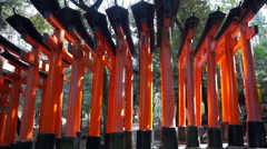 Red gate tori at Fushimi Inari temple shrine in Kyoto, Japan Stock Footage