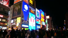 Timelapse shot of Glico billboard Osaka Japan landmark Stock Footage