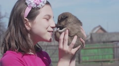 Happy little girl with a puppy, Slow Motion Stock Footage