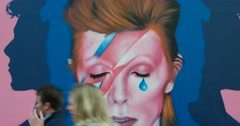 People Walk Past David Bowie Mural in New York City 4K Stock Video Stock Footage