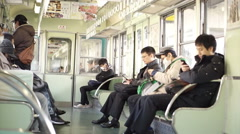 Local Japanese people riding the train out to Kyoto in the morning Stock Footage