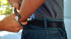Police arresting man - stock footage